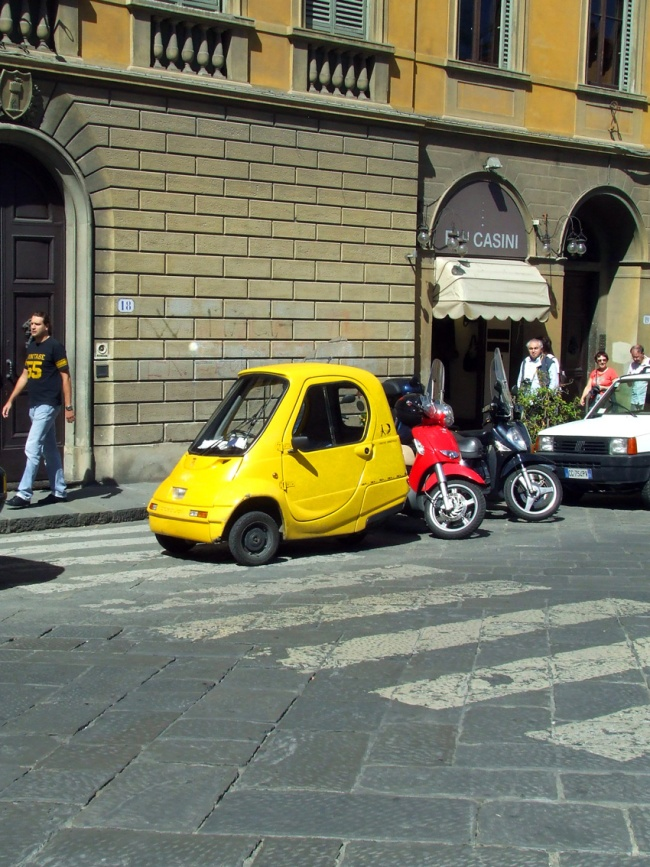 Florence yellow car street Italy