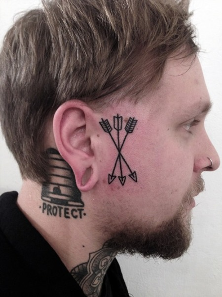 Cool-Face-Arrow-Tattoo-for-Men