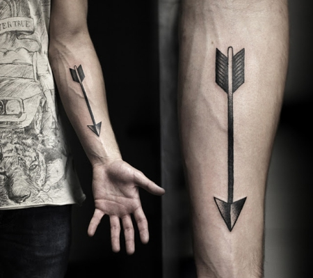 kamil-czapiga-black-arrow-tattoo-on-arm
